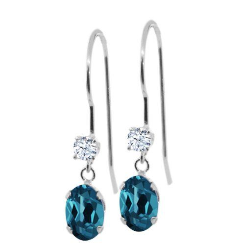 1.26 Ct Oval London Blue Topaz White Topaz 14K White Gold Earrings. This item is proudly custom made in the USA. 100% Satisfaction Guaranteed. Gemstones may have been treated to improve their appearance or durability and may require special care.