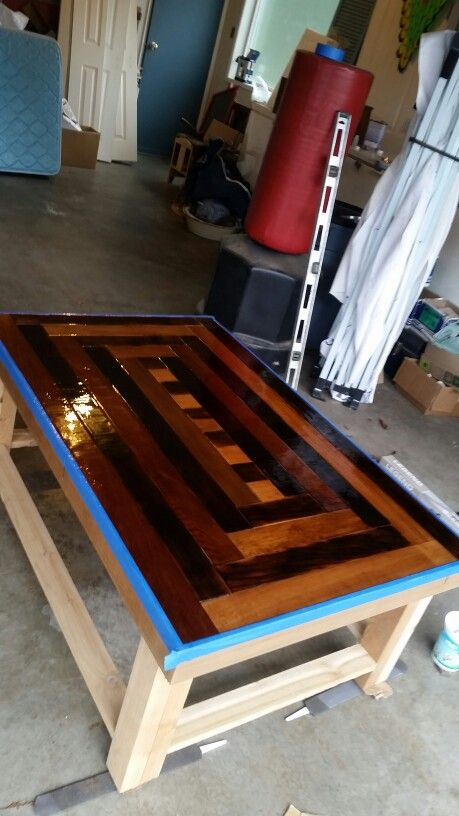 Custom spiral cedar table top with interlocking center design. Coated with clear casting resin to give smooth glass like top.