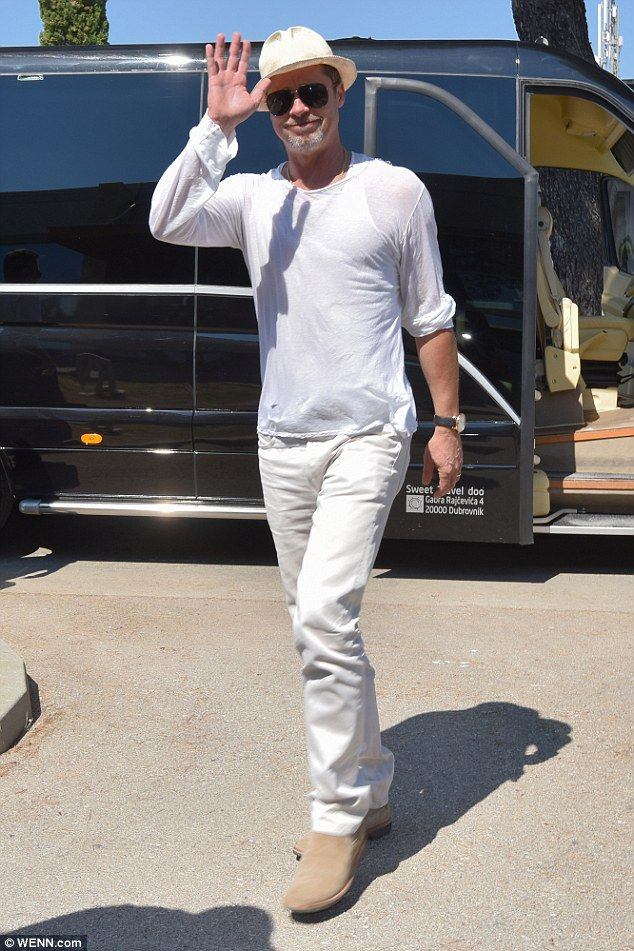 Greetings: Brad Pitt gave a jovial wave as he was seen at Zadar, Croatia airport on Friday...