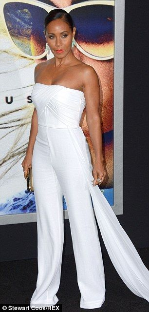 Gorgeous: Jada, 43, showed off her fabulous figure in a strapless white pantsuit, displayi...
