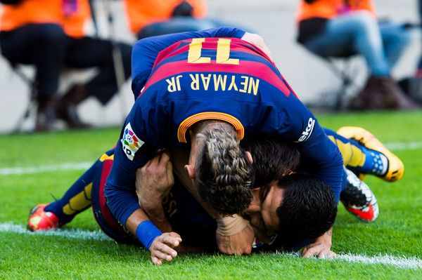 Neymar Santos Jr (top) and Lionel Messi (middle) of FC Barcelona celebrate with their teammate Luis Suarez (R) after he scored his team's second goal during the La Liga match between FC Barcelona and Club Atletico de Madrid at Camp Nou on January 30, 2016 in Barcelona