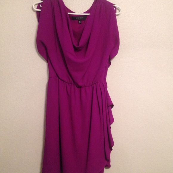 Nine West petite dress Simple but cute purple dress. Flaw interior of dress: Lining Is ripped on the side Nine West Dresses