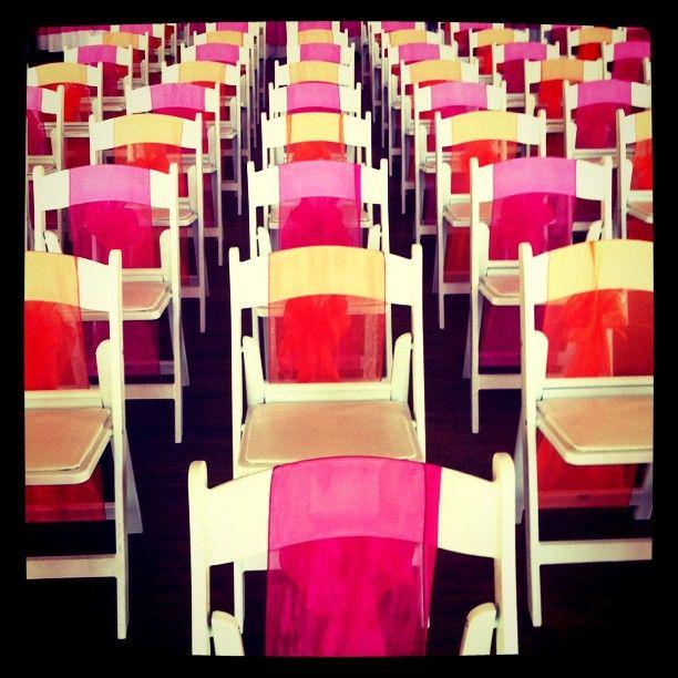 Via Twitter RT @HeyJarret   Orange and pink wedding chairs. instagr.am/p/KD2xx/