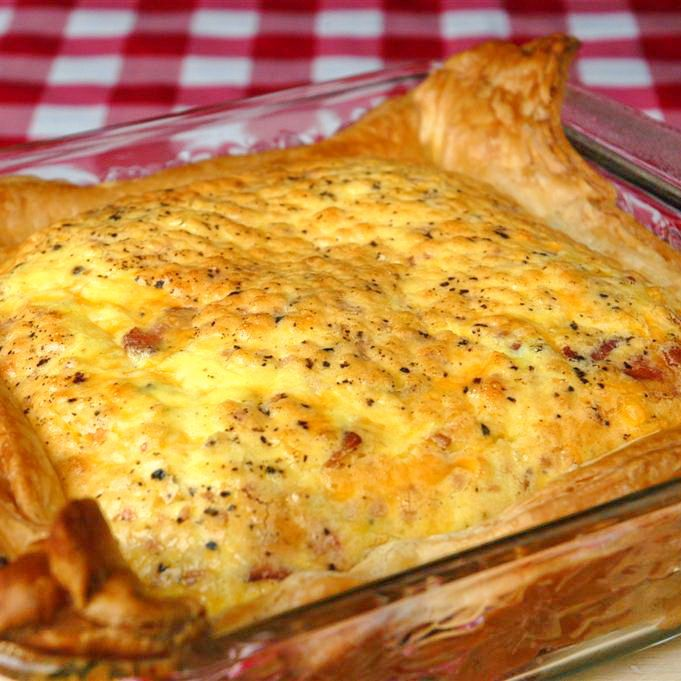 This simple bacon and cheddar quiche is a really quick and easy recipe for Sunday brunch. No need to make pastry, just use store bought frozen puff pastry. No need to roll out the pastry either or even trim it into a circle for a standard pie plate, just use a square baking dish instead …