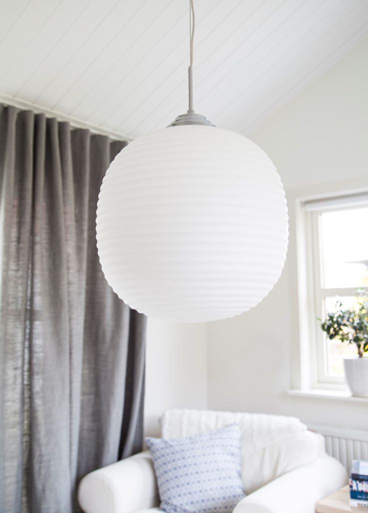 Cool white glass pendant with a chromed metal base for living rooms  Vitro