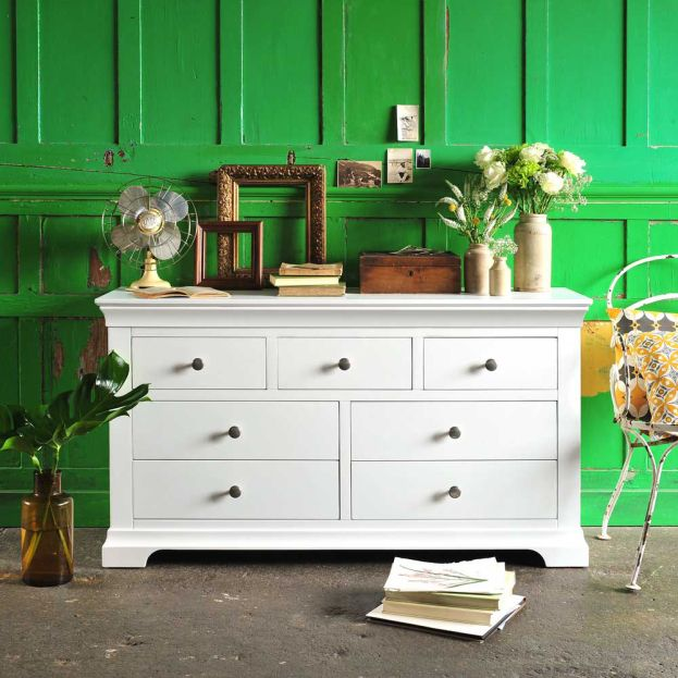 White bedroom furniture, chantilly, bright green wall, vintage ceramics, panelled wall, cream fan