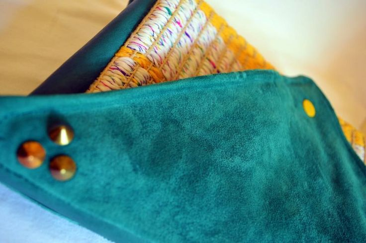 Tropical Clutch  2014 Made by JOTACA Up cycled non-slip mat woven with white and yellow cotton wool, suede turquoise, and studs