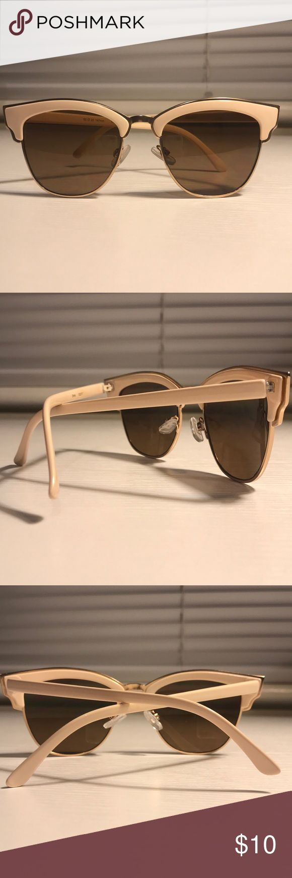 Very Light Pink/Ivory Cateye Sunglasses Very light pink, more ivory colored, Cateye sunglasses. Accessories Sunglasses