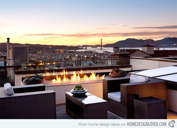 Look at that view! A look at the city as well as the mountains and the sky will no doubt make you love life even more. This modern terrace is also well designed with a modern outdoor pit fire.