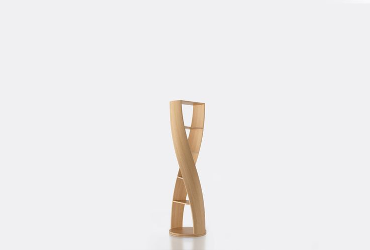 Cylindrical shelf from the collection MYDNA by Joel Escalona, with four shelves and swivel base. Made of wood and heavy-duty fibers. Finished in natural wood or semi-gloss lacquer. - MYDNA Oak #Bookcase #furniture #design #shelf #nono #coolinteriors