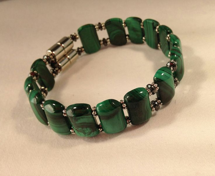 MALACHITE-A protective and transformative stone, enhances well being, brings good fortune, prosperity and abundance. Physically it aids in arthritis, rheumatism symptoms, helps mend broken bones and torn muscles. Gives relief from asthma and swollen joints. Believed to cleanse the body at a cellular level. Improves immune system, eases childbirth pain.