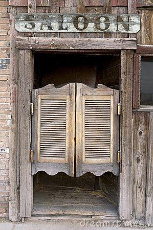 Old Western Swinging Saloon Doors by Carl Keyes, via Dreamstime