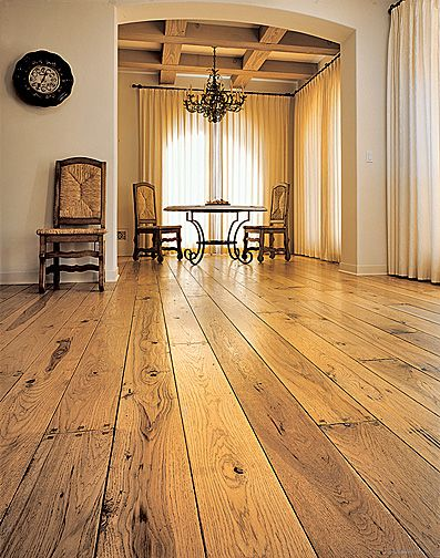 Hardwood Floor Design Ideas light hardwood flooring and dark wooden cabinetry compliment each other in this kitchen featuring light tile Rustic Hardwood Floors