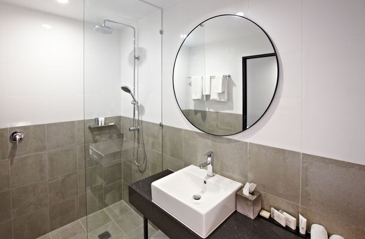 Rydges Fortitude Valley's bathrooms feature double shower heads, plenty of bench space, level floors, funky mirrors, and lots of storage.