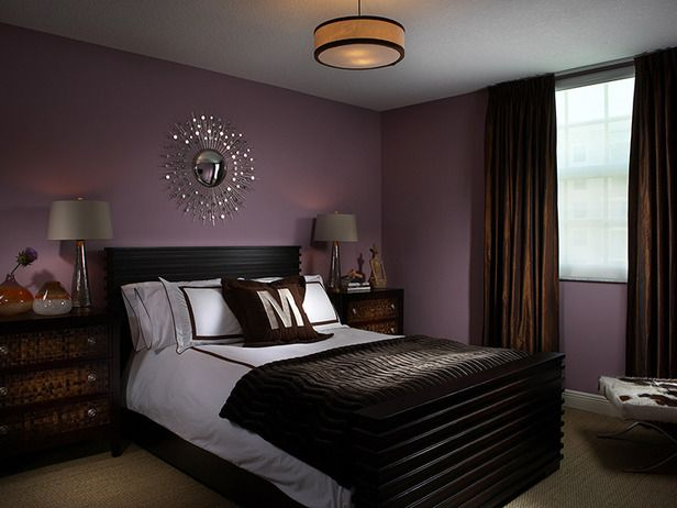 I think my daughter will like this...Dark, Soothing Color: Using dark colors in a bedroom can make the space feel cluttered and small when used incorrectly, but these chocolate-brown draperies set a soothing tone against the lavender walls of this contemporary bedroom. To bring some sparkle to the space, designer Joseph Pubillones hung a mirror above the bed.