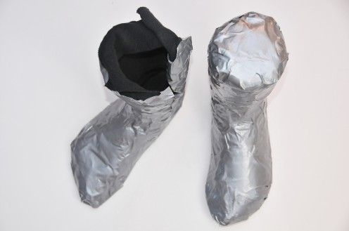 How to make duct tape shoe lasts for wet felted boots or slippers. Great idea. For a more customized fit, one could cover feet with a shopping bag, then tape around your own feet to make personalized forms.