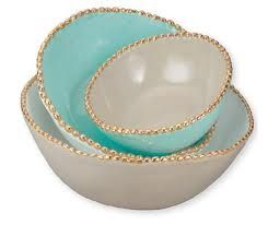 Aqua and white bowls embellished with gold.