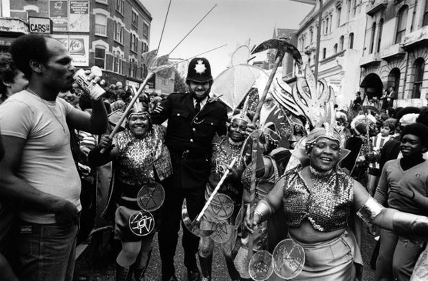 Notting Hill Carnival London 1976 A Policeman dancing has now become an annual feature.