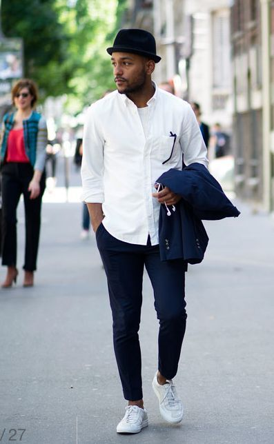 Shop this look on Lookastic: https://lookastic.com/men/looks/suit-long-sleeve-shirt-crew-neck-t-shirt-low-top-sneakers-hat-sunglasses/10417   — Black Wool Hat  — White Crew-neck T-shirt  — Black Sunglasses  — White Long Sleeve Shirt  — Navy Suit  — White Low Top Sneakers