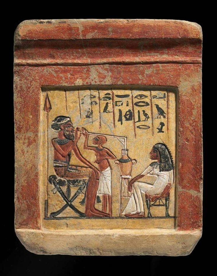 Limestone stele of a Canaanite soldier drinking beer using a straw in the company of (possibly) his Egyptian wife or mistress and a servant. Reign of Akhenaten c.a. 1351-1334 B.C.Eighteenth Dynasty,Tell el-Amarna •Agyptisches Museum in Berlin•
