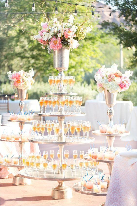 Photographer: Amy & Jordan; Elegantly unique outdoor wedding reception with champagne display;