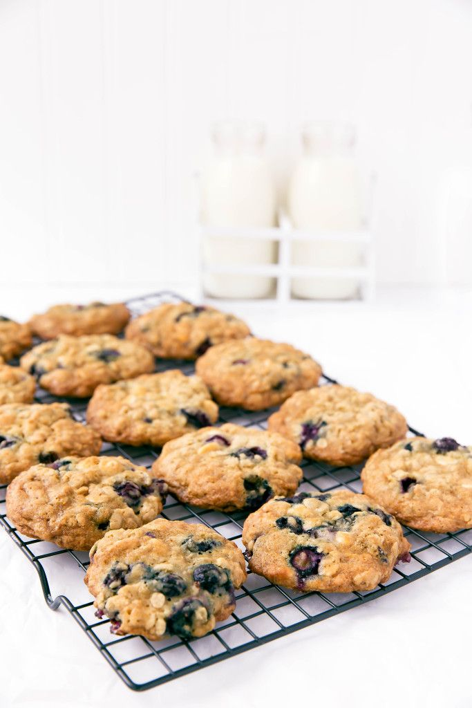 Chewy oatmeal cookies studded with white chocolate and fresh blueberries. A perfect summer treat!