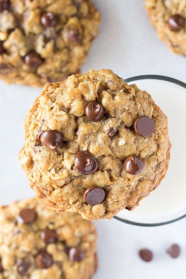 Soft and chewy oatmeal chocolate chip cookies made with brown sugar, old fashioned oats, walnuts & lots of chocolate chips. The perfect bakery-style cookie!
