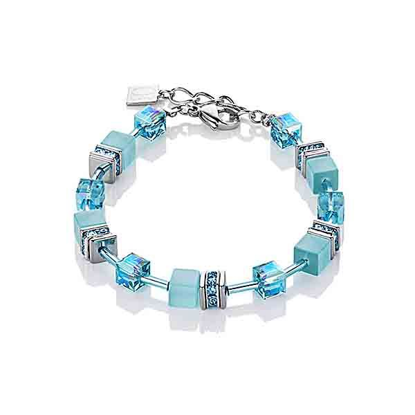 Synthetic, solid-coloured tiger's eye combined with Swarovski® Crystals, rhinestone rondelles with Swarovski® Crystals and stainless steel. Elegantly and delicately combined with fine glass cylinders in this beautiful cool turquoise blue. Earring hooks rhodium-plated sterling silver.