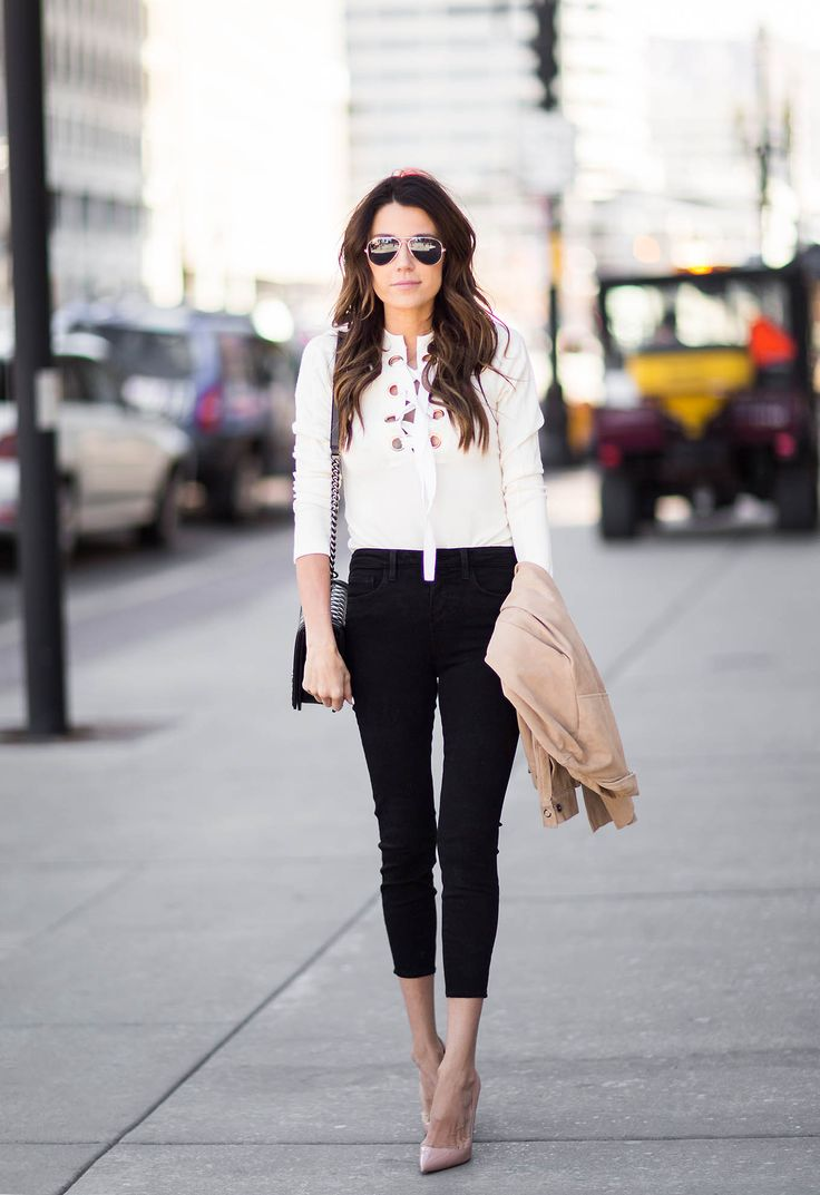 Christine Andrew rocks the hot new trend which is the lace up blouse! Paired with cropped skinny jeans this blouse is perfect for a sophisticated but edgy overall look.   Blouse: Intermix, Jeans: Nordstrom, Heels: Neiman Marcus.