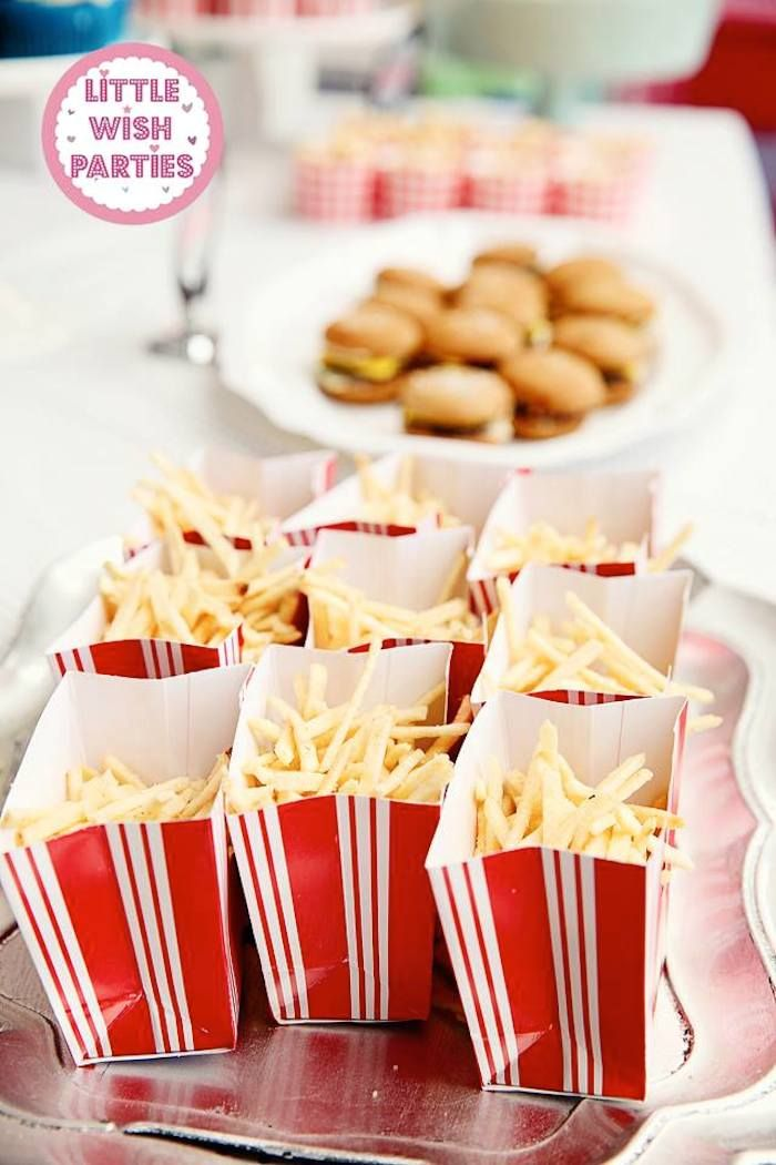 1950's Diner + Rock n Roll themed birthday party via Kara's Party Ideas KarasPartyIdeas.com Cake, decor, printables, favors, food, supplies, and more! #retroparty #retrodiner #1950sparty #vintagedinerparty #vintagediner #rocknroll (6)