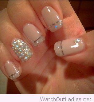 Nude and silver glitter manicure