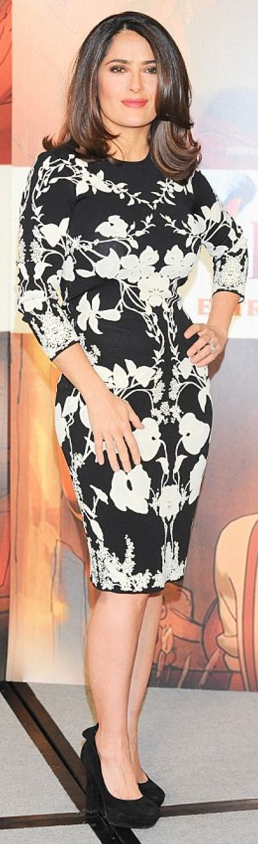 Who made  Salma Hayek's black platform pumps and white floral dress?