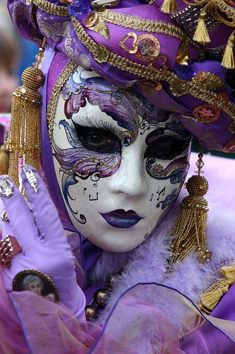 Lady in purple with musical mask