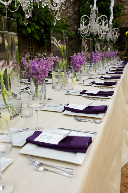 This purple table setting agrees perfectly with our chandeliers.  @Haiku Mill