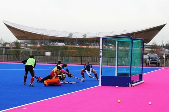 pink Olympic field hockey field in England