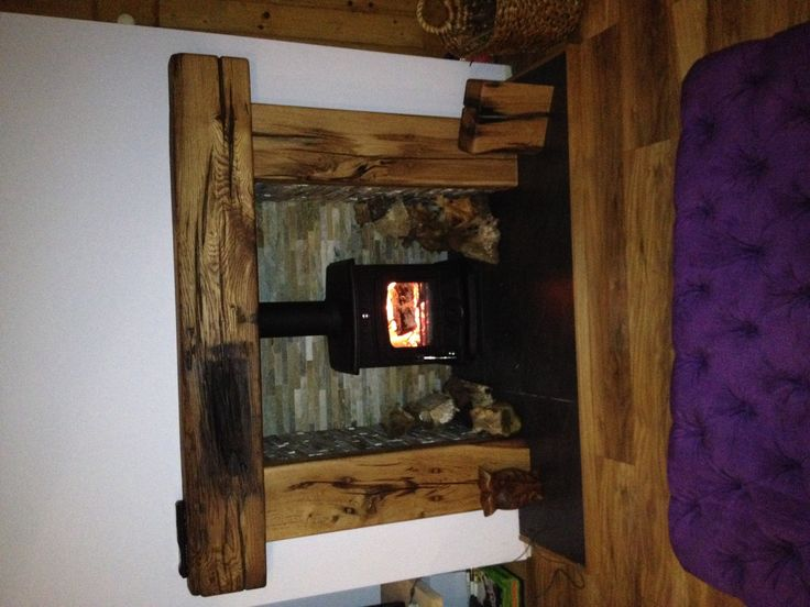 New log burner with split faced slate tiles and French oak fire surround