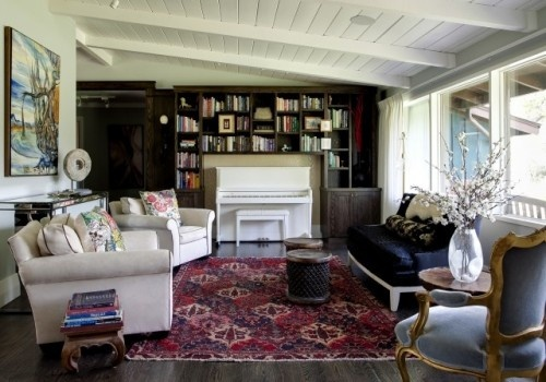 Built-in bookcase surrounding upright piano...