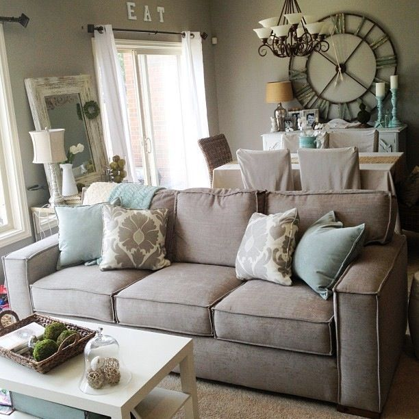 I really like this because the color scheme is very basic for Living room designs with grey sofa