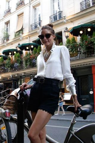 scalloped edge shorts + top knot + classic white blouse + bike = chic street style #oliviapalermo