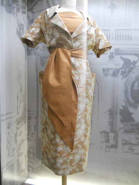 Eva Peron, side-tied sash on this dress.