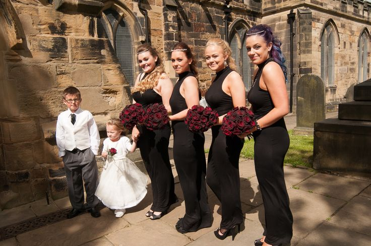 My gorgeous bridesmaids, flower girl and page boy. Black, silver, ivory. Black roses. Curls
