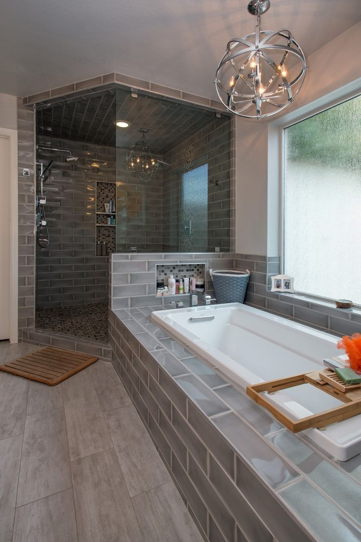 modern with industrial touches live the gray tiles and chandelier bathroom remodel pictures
