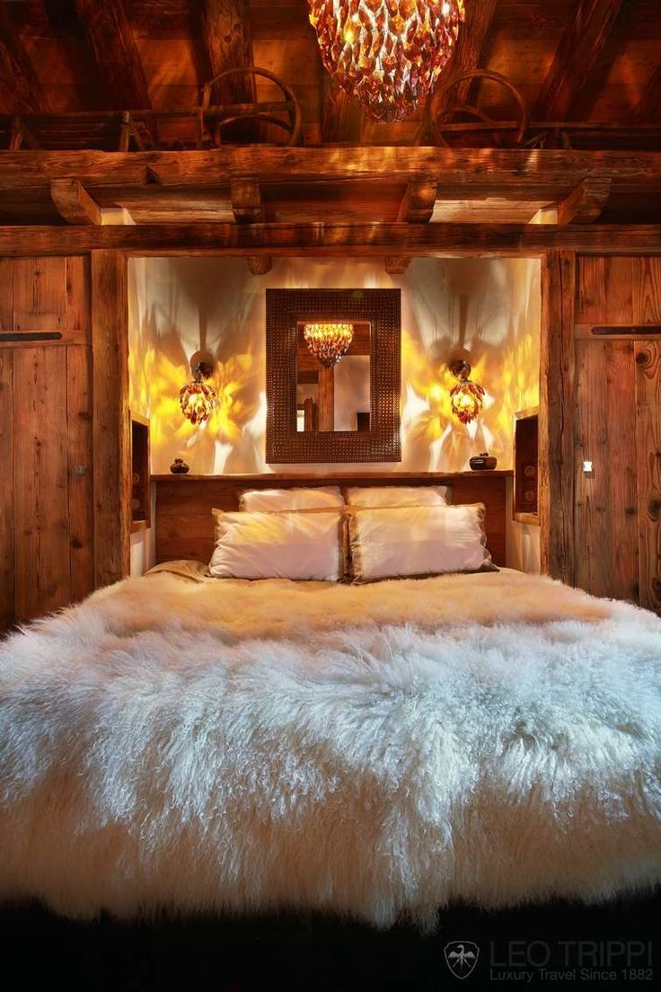kinda a weird choice in light fixtures and bed cover, but i like the style of the bed and beams.