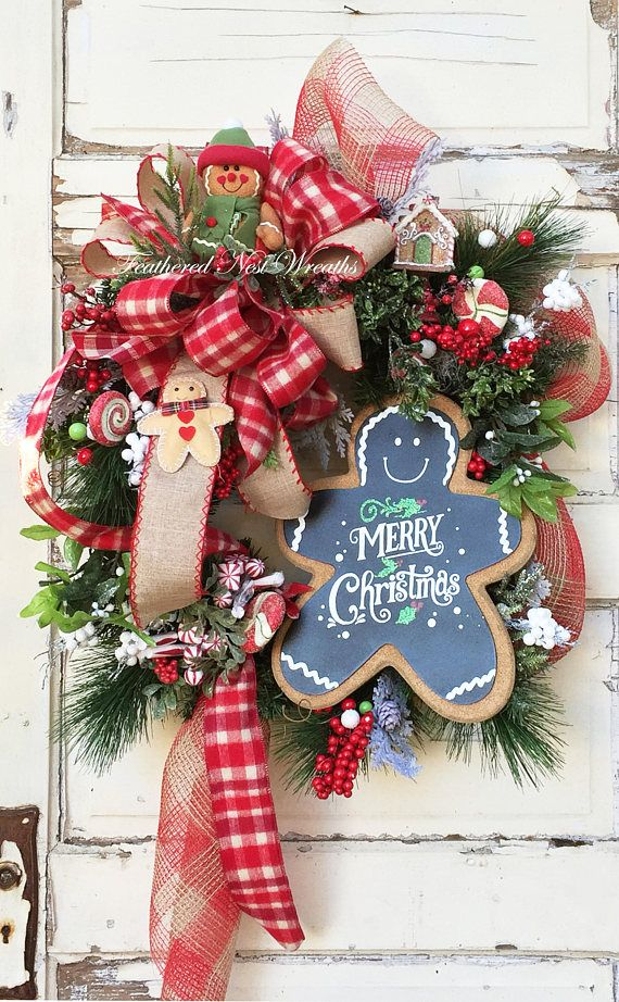 This Fun Christmas Wreath is made on a Pine Base. I have Layered it an Assortment of Pine, Red Berries, Faux Peppermints and Candies, White Berries, A Small Gingerbread House and a Burlap Covered/Chalkboard Gingerbread Man Sign. The Wreath is Finished out with a Large Checked