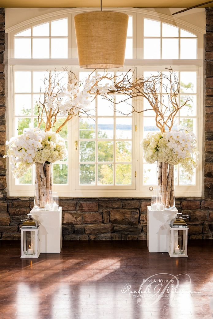 Glamorous Wedding Ideas - Unique Altar Design.White flowers, branches and lanterns give it a more rustic clean vibe.