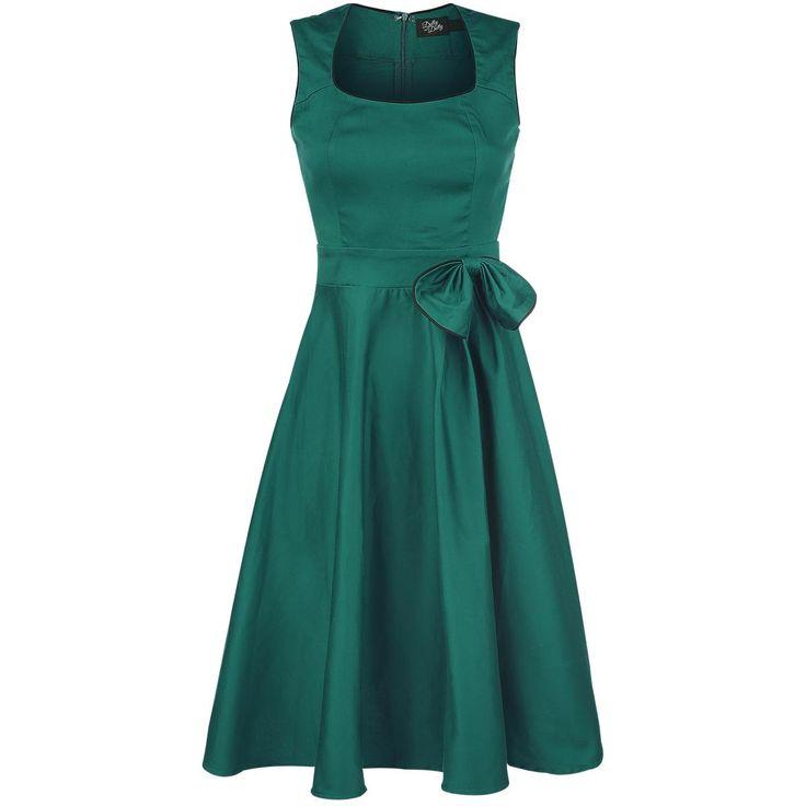 """- met strikapplicatie - rits in de achterkant - lengte: ongeveer 110 cm  Samen met de dames en heren van Dolly and Dotty nemen we je mee terug naar de jaren 50! Hier kun je de groene """"Bow Dress"""" vinden van Dolly and Dotty. De vintage jurk ziet er heel leuk uit dankzij de leuke semi-swing rok en de strikapplicatie maakt het ontwerp compleet. Wij houden van de stijl van de jaren 50. De lengte van de jurk is ongeveer 110 cm."""