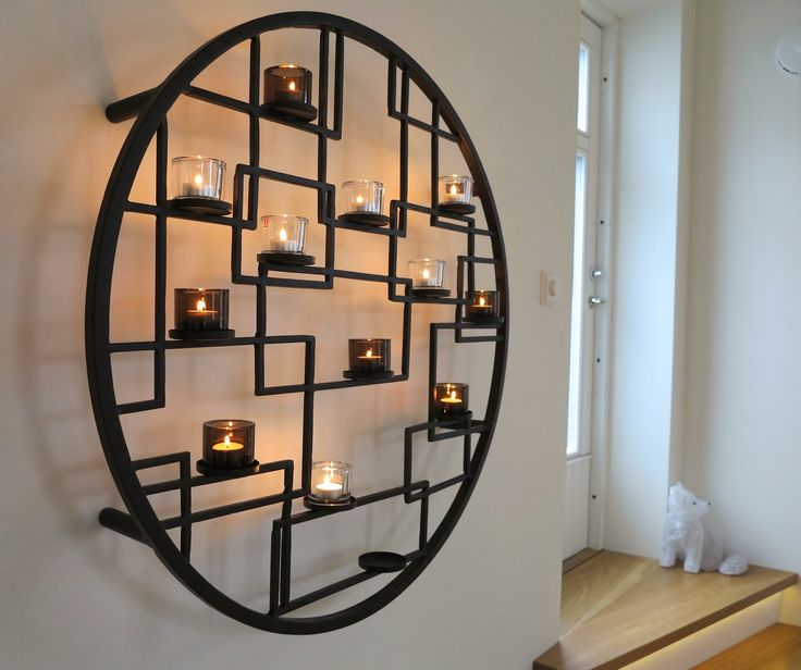 Kivi-candles by Iittala in a round metallic stand - a wall full of candles!