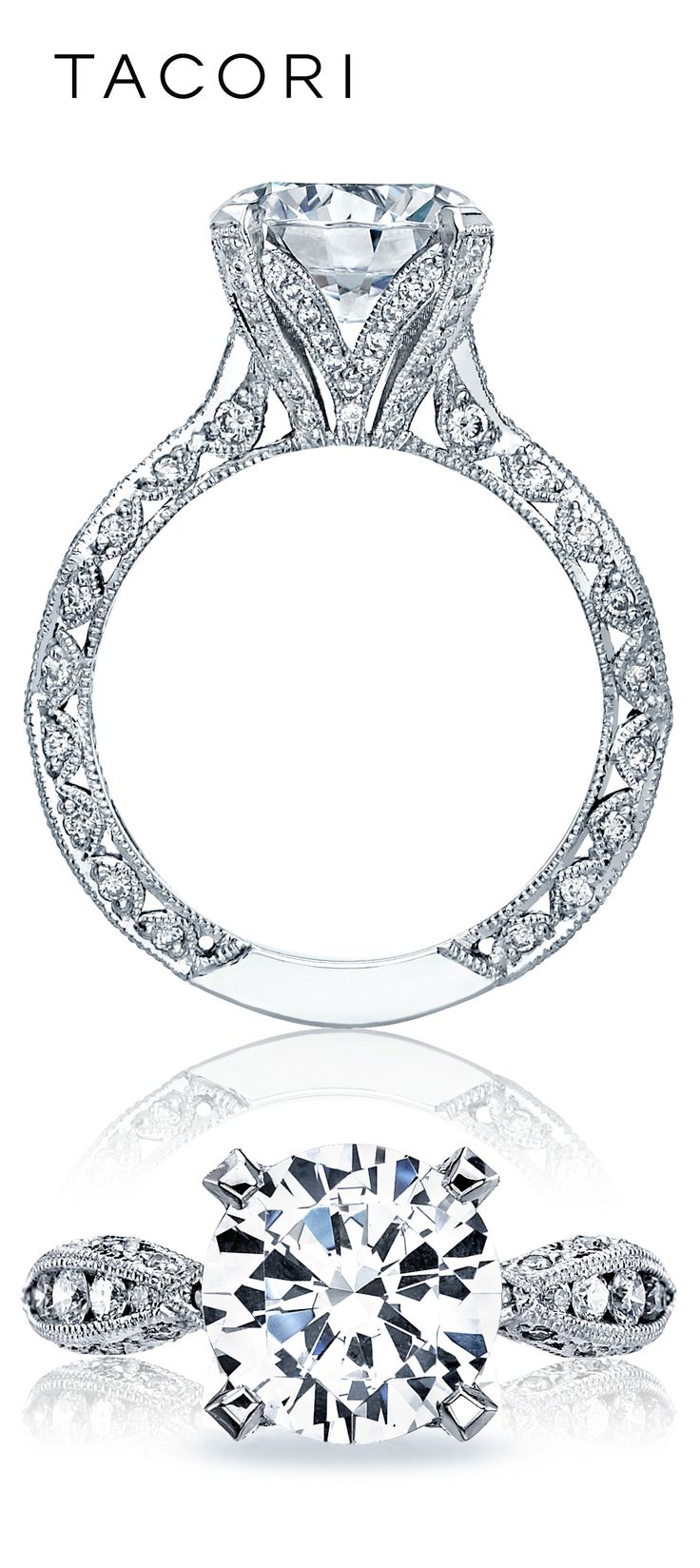 "A Tacori Girl favorite is further beautified in the ""RoyalT"" collection, taking the popular pave-set ribbon band and enhancing it for a 3.50 carat brilliant round center stone. The intricate 4-pronged, pave set gallery beneath the center diamond is evocative of a budding flower reaching ultimate beauty. Can you say breathtaking?"