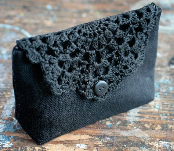 This elegant pouch/clutch is made of pure linen and closes with hand crocheted doily detail and button. Lined with cotton fabric. Lightweight. Approx.