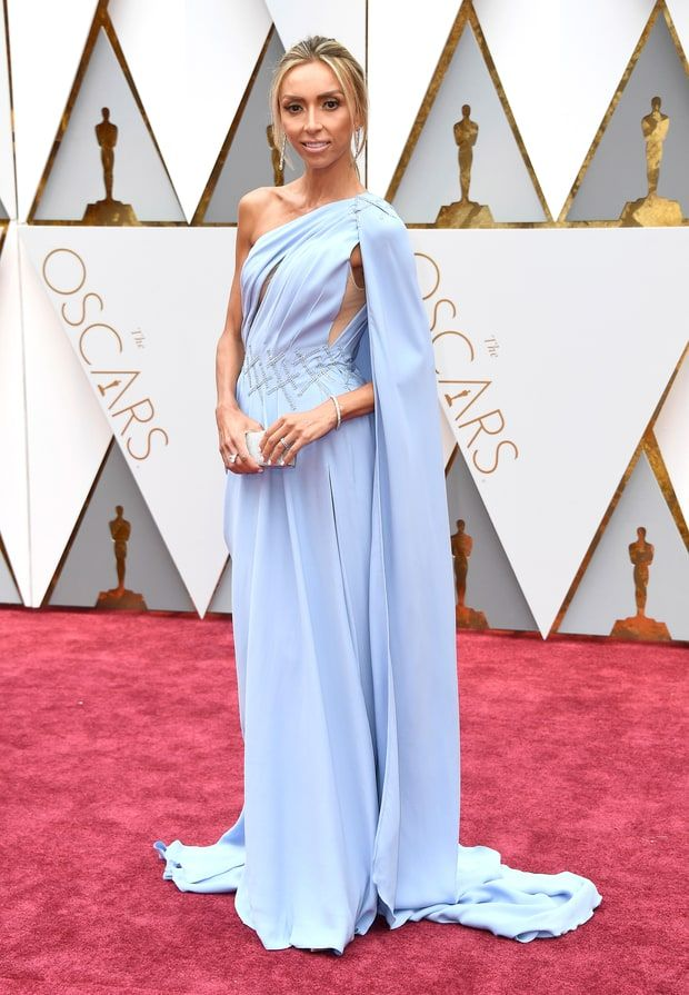 2017 Oscars: Giuliana Rancic is wearing an ice blue one shoulder Georges Chakra Couture gown with a side cutout. The color is lovely on her!